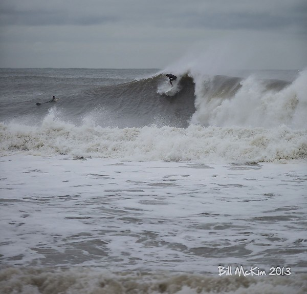 Shuan McGrath sliding down a 12 foot plus wave, in Belmar NJ. Photo by Bill McKim.