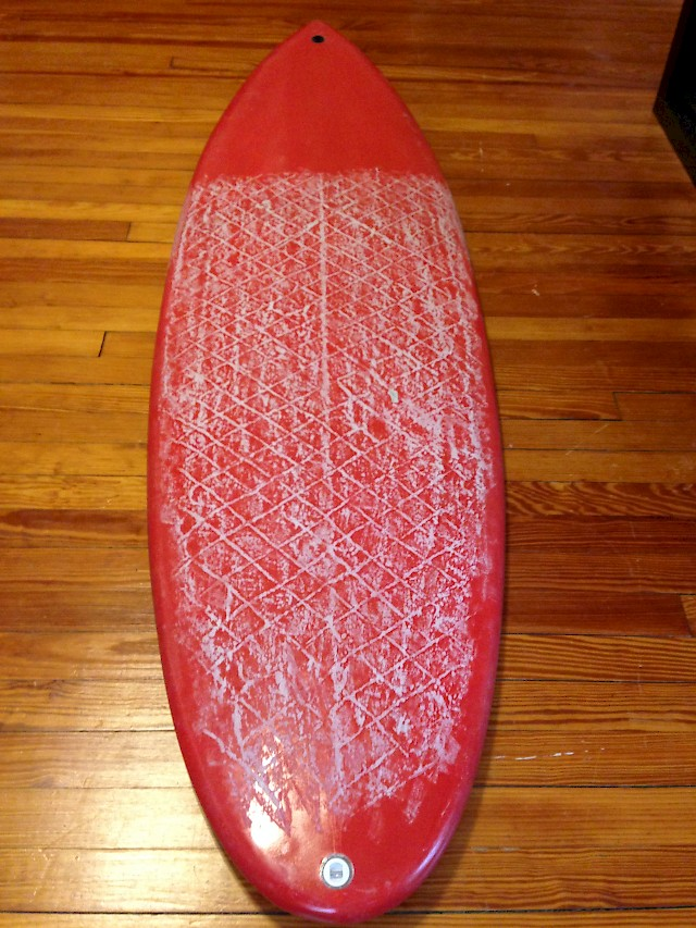 Board completely waxes with a nice tacky top coat and cool pattern. Notice the rails are waxed.